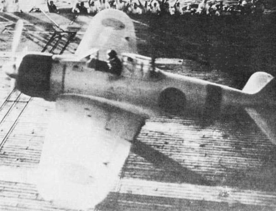 Flight Officer 1st Class Shinpei Sano launches from the flight deck of the Akagi in an A6M2 model 21 Zero after sunrise in the second attack wave. Sano died in the Battle of Midway in June, 1942.